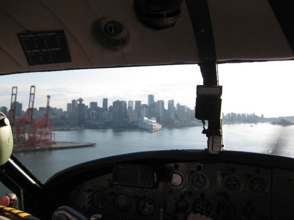 Views from the seaplane cockpit, airborne, onto downtown Vancouver, Canada Place, Coal Harbour