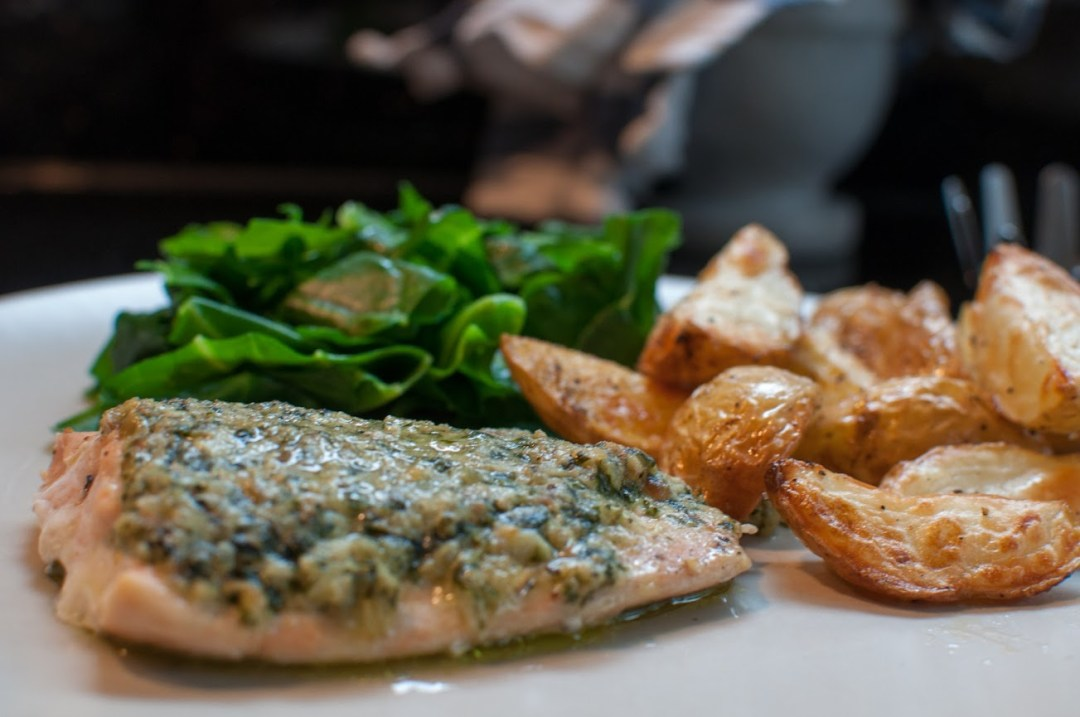 Pesto crusted salmon with greens and potatoes