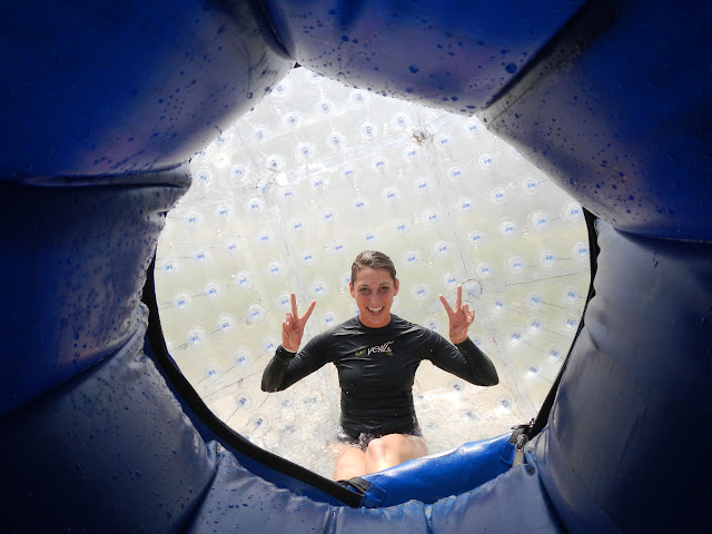 Meagaan at the end of her zorb ride, all soaked after her zig-zag washing machine spin programme