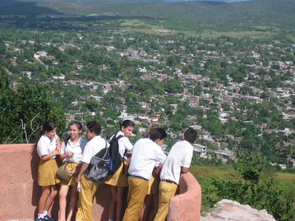 Secondary school children looking out over Holguin, Cuba