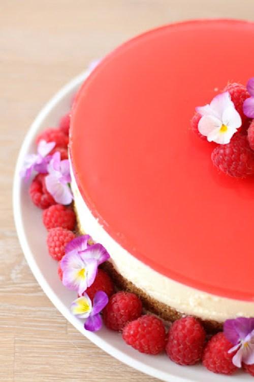 Raspberries and pansies on a cheesecake