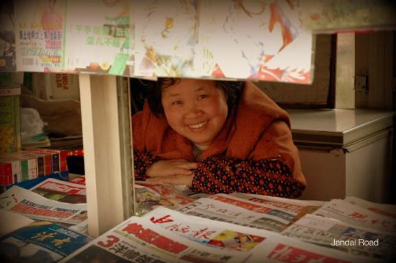 Woman at news stand, Nanjing, China