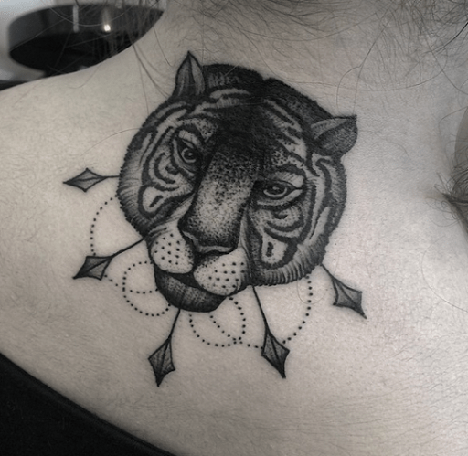 Arrow tattoo behind neck