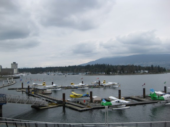 Sea planes in Coal Harbour, Stanley Park in the background