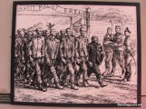 Prisoners Returning from Work Carrying Their Dead.JPG