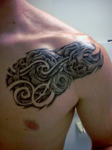 Cloud tattoo on chest for men