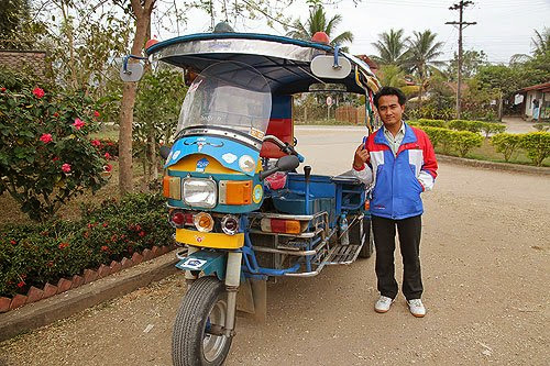 laotian tuk-tuk, getting around in Laos, taking the bus in laos