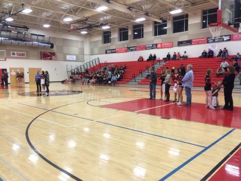 Winter season cheerleaders recognized on their senior night