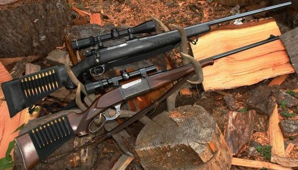 """The rifle on top has a black stock, telescopic sight and is a bolt-action. The one on the bottom is a lever-action, with a scope. Is one a """"sniper"""" rifle and the other a """"hunting"""" rifle? (Dave Workman photo)"""