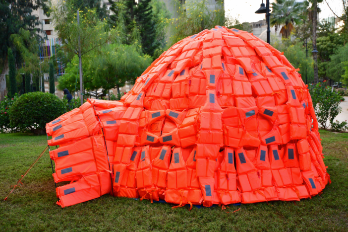 "Belgium's Cathy Weyders made ""Rescue Igloo, Moving Worlds"" with life-jackets on site in the garden 