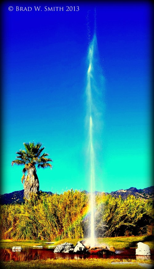 geyser shooting 100 feet in the air, blue sky