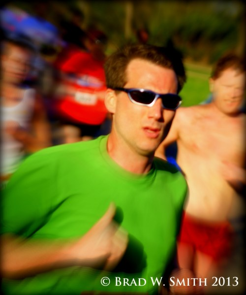 white man, sunglasses, green shirt, giving thumbs up sign