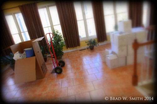 tile floor, window wall, stacked boxes, 2-wheel cart