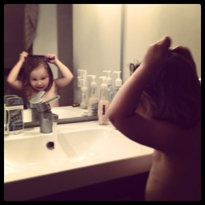 Wetting and 'Flatting' her hair to make it beautiful