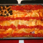 Shows a lasagna that looks like an American flag.