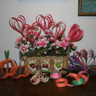 Image shows collection of crafts made from strips of construction paper.