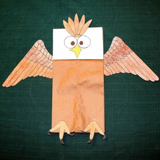 Image shows a paper bag decorated with an eagle's face, wings and feet to make a patriotic craft.
