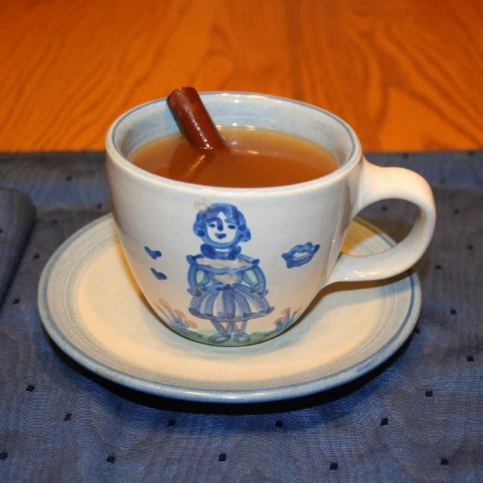 Image shows a Mary Alice Hadley cup filled with mulled cider and garnished with a cinnamon stick.