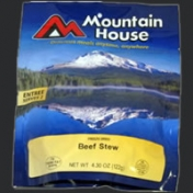 Image shows a foil pouch with Mountain House beef stew in it.