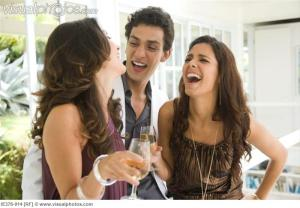 Man laughing with women