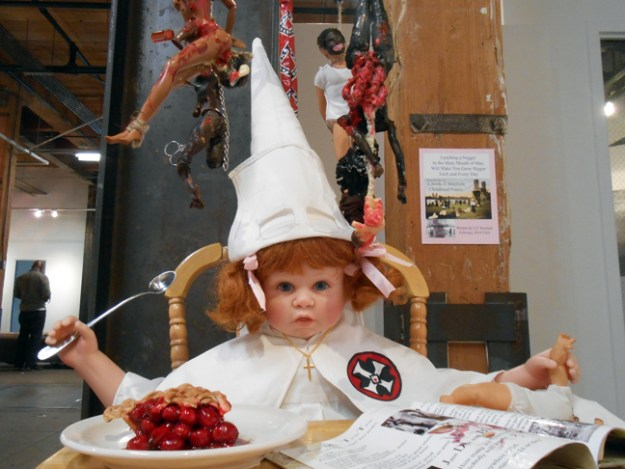 Lili Bernard. As American as Cherry Pie (detail), 2014. Baby doll parts, Barbies, highchair, baby mobile, nails, cotton fabric, rope, chain, scissors, digital photos, children's book, acrylic paint, 24″x28″x52″ Available for purchase
