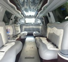 interior photo of cadillac escalade limo with 3 bars, sound system, laser lights photo