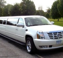 cadillac escalade 20 passenger stretch in white photo
