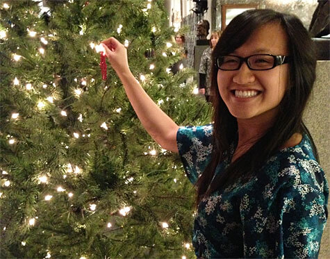 Placing an ornament on a tree at the Edmonton Singing Christmas Tree!