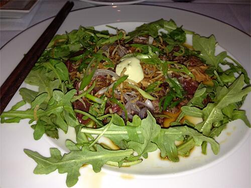 Alberta Beef Tataki (Wasabi aioli, sliced shallot, arugula, Turkish olive oil, sea salt, crispy potato) from XIX Nineteen.