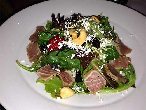 California San Mateo (Organic greens, fresh BC berries, toasted cashews and chèvre cheese with honey mustard dressing with pepper crusted Yellowfin tuna) from XIX Nineteen.