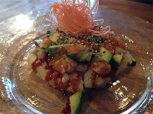 Pizza Sushi - deep fried sushi rice topped with salmon, tobiko, scallops, mayo, avocado, sesame seeds & sweet soy - $8.95
