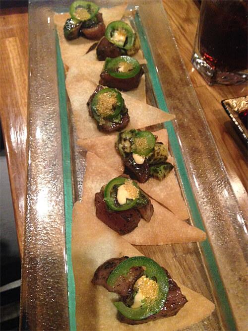 Tuna Nachos - spicy sesame tuna with tobiko, avocado, sesame seeds & jalapeño on crispy wonton chips - $13.95