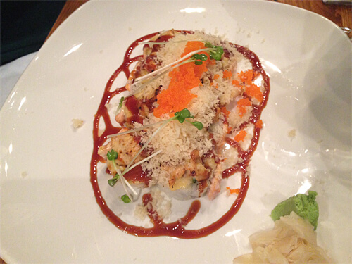 Love Crunch rolls - baked crab, avocado roll with salmon and spicy tuna, tempura bits, sweet soy and tobiko - $17.95