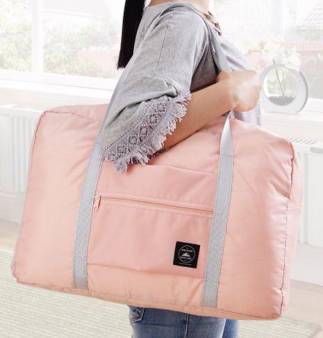 Reisebag til koffert lys rosa miljøbilde