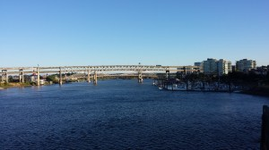 Walking across the Hawthorne Bridge looking at the I-5 Marquam Bridge and the new Tillikum Crossing Bridge beyond.
