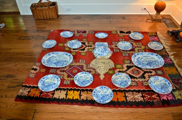 First we measured the area and folded a rug to the exact size—then arranged the china on the rug to get the perfect spacing