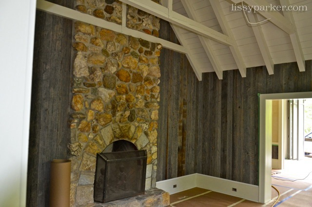 Old gray barn wood lines the library walls—white ceiling adds light to the room