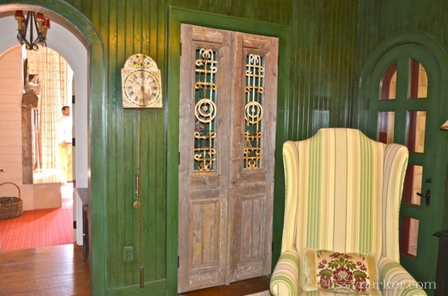 Glorious green paneled wall line the office—TV area