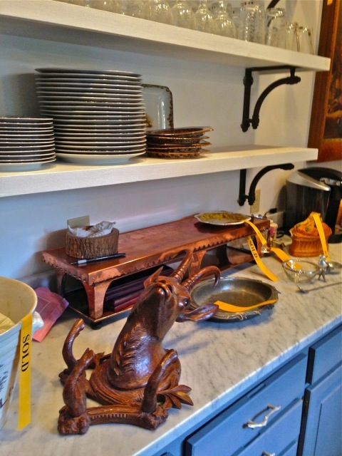 This copper serving tray was wonderful along with the black forrest rams head—love the open cabinets