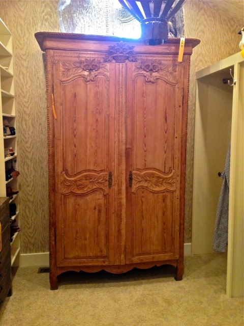This large armoire is used for storage in the closet—beautiful idea