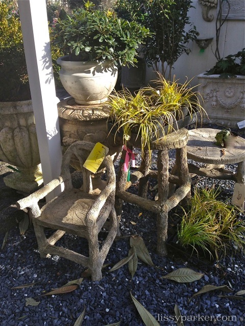 Faux bois chairs and tables are also in the garden