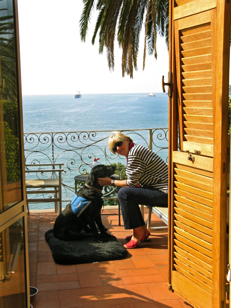 Mac and Row on a beautiful balcony in Italy