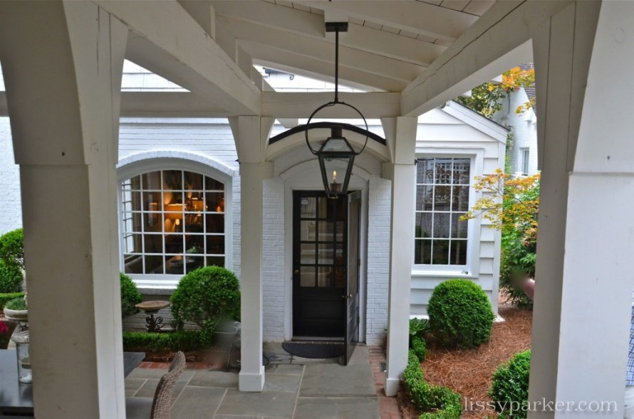 This breezway connects the house, pavilion and garage—high gloss black door is beautiful