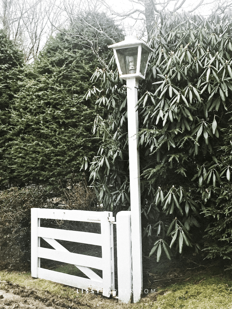 A second gate leads to another porch and shed