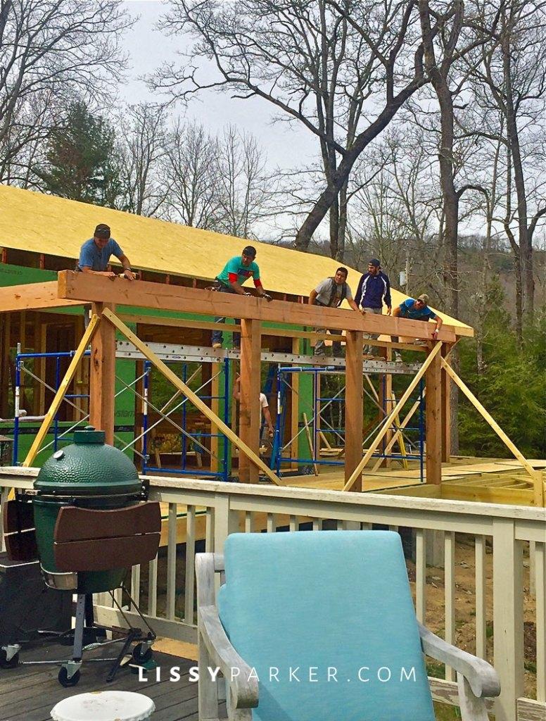 Men setting beams on a porch