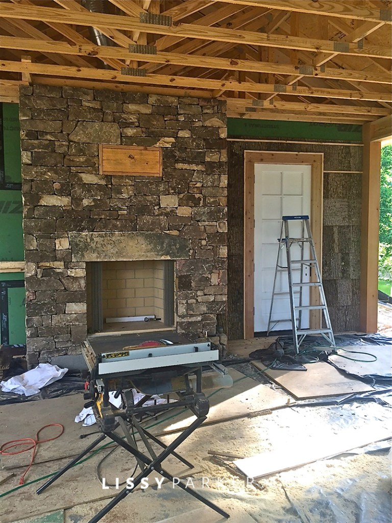 stone fireplace and bark walls