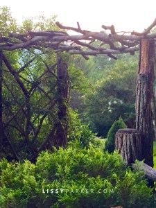 rustic twig gazebo entry to garden