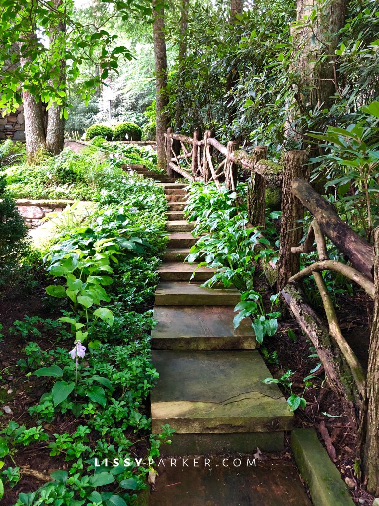 stone steps and rustic rail