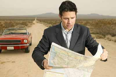 Man Looking At A Map While Stopped On A Country Road Uid 1