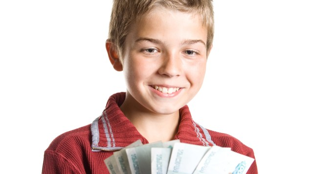 The young boy holds money in hands